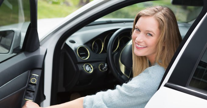 blonde girl in car